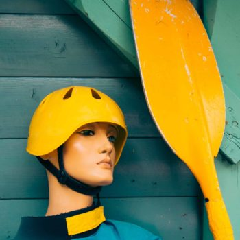 Mannequin with kayaking equipment, water sports and rowing background with copy space